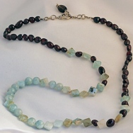Checkmate Necklace with Aquamarine and Garnets
